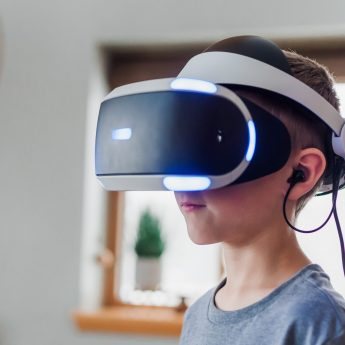 kid-using-virtual-reality-headset-3405456